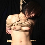 Traditional shibari  slave and master achieve a very artisitc rendering of shibari bondage technique. Slave and Master achieve a very artisitc rendering of Shibari bondage technique